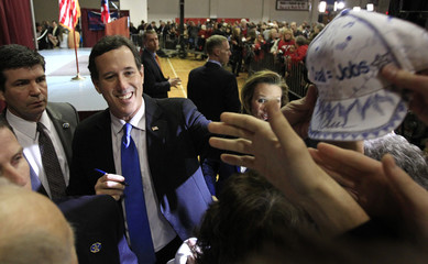 """Republican U.S. presidential candidate Rick Santorum greets supporters at his """"Super Tuesday"""" primary election night rally"""