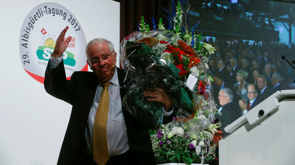 Former Swiss Minister and National Councillor Blocher of the Swiss People's Party holds a bunch of flowers during the traditional 'Albisguetli-Tagung' party meeting in Zurich