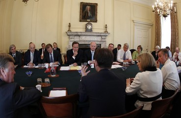 Britain's Prime Minister David Cameron listens to Deputy Prime Minister Nick Clegg during their cabinet meeting at 10 Downing Street, in central London