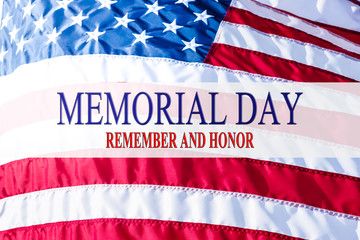 Text Memorial Day and Honor on flowing American flag background. Concept of Memorial day or Veteran's day in America. Wall mural