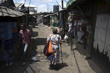 A woman walks on a street at the Mukuru Kwa Njenga slum in the capital Nairobi