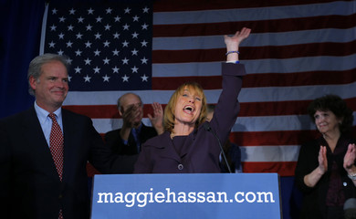 Democratic New Hampshire Governor Maggie Hassan celebrates her re-election with her husband Tom at her side at her election night rally in Manchester