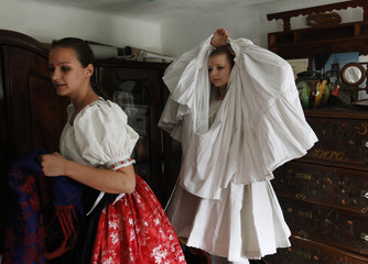 Girls prepare for traditional Easter celebrations, during a media presentation in Holloko