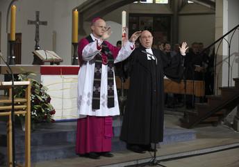Overbeck, Bishop of Essen and Schneider, the Protestant church leader speak during a memorial service in Salvator Church (Salvatorkirche) in Duisburg