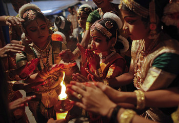 School girls offer prayer before a performance of Indian classical dance on the occasion of Mahashivratri festival in Thiruvananthapuram