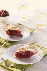 Two Slices of Mixed Berry Pie with Ice Water