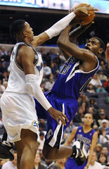 Wizards' Young defends a drive by Kings' Evans during the second half of their NBA basketball game in Washington
