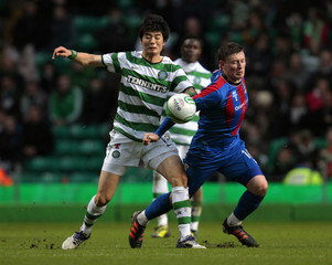 Celtic's Ki Sung-yeung fights for the ball with Inverness Caledonian Thistle's Shane Sutherland during their Scottish Premier League soccer match at Celtic Park stadium in Glasgow