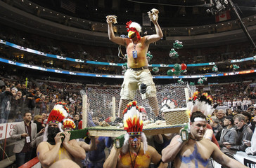Competitor Wild Turkey is carried into the arena on a platform for Wingbowl 19 the annual chicken wing eating contest in Philadelphia