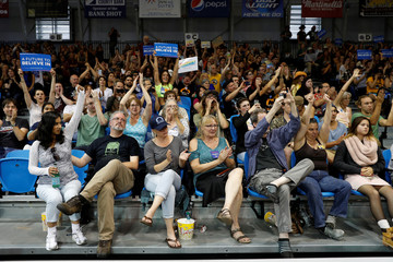 People listen as Democratic U.S. presidential candidate Bernie Sanders speaks during a campaign rally in Santa Cruz, California