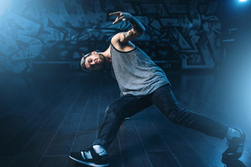 Breakdance performer posing in dance studio