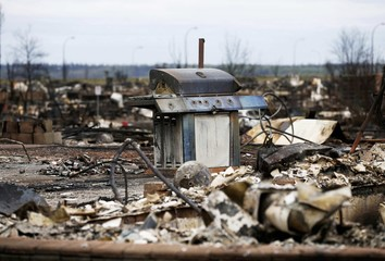 The burnt remains of a barbecue are pictured in the Beacon Hill neighbourhood of Fort McMurray