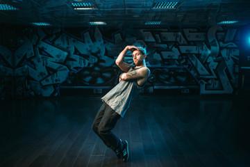 Male rapper in dance studio, rap performer