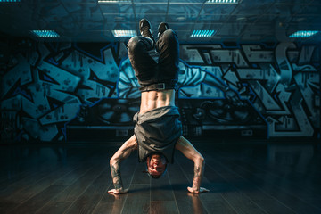 Young breakdance performer, upside down motion