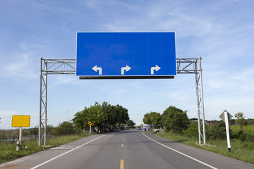 Blank road sign on highway road.
