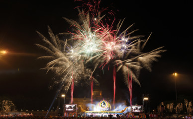 Fireworks explode over Royal Plaza and a portrait of Thailand's 82-year-old King Bhumibol Adulyadej during the anniversary of his coronation in Bangkok