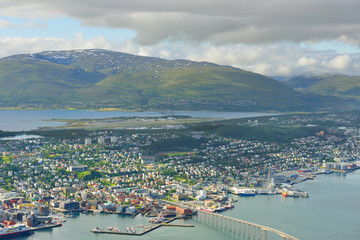 View of Tromso against background of Norwegian Sea and picturesque mountains. Northern Norway