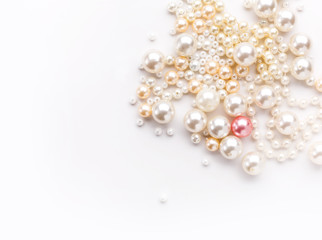 Pile of colorful pearl on white background