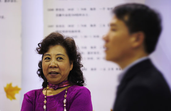 A woman looks at a man during a government-sponsored matchmaking event for middle-aged singles and seniors in Shanghai