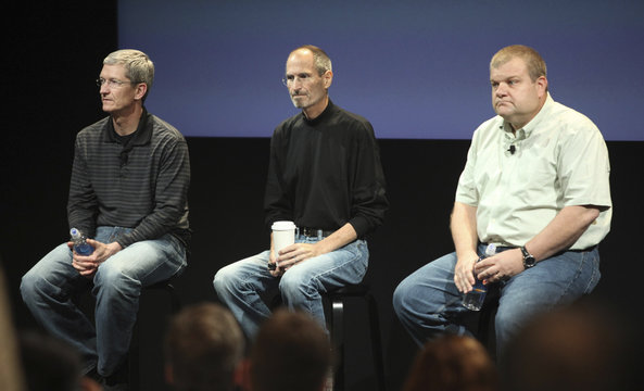 Apple COO Cook, CEO Jobs and Mansfield, senior VP, Mac Hardware Engineering appear onstage during Q&A period at news conference on antenna problems with the iPhone 4 in Cupertino