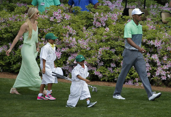 Skier Vonn walks with U.S. golfer Woods and his children Sam and Charlie during the par 3 event held ahead of the 2015 Masters at Augusta National Golf Course in Augusta