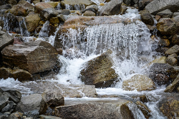 Rocky cascade in the mountains