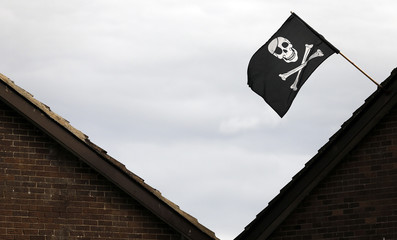 The Jolly Roger flies from a house in the Loyalist Ballymacash estate on the outskirts of the city of Lisburn