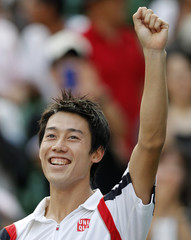Nishikori celebrates his win over Baghdatis after their men's singles semi-finals match at the Japan Open tennis championships in Tokyo