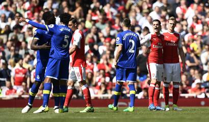 Arsenal's Granit Xhaka clashes with Everton's Morgan Schneiderlin, Romelu Lukaku and Ashley Williams