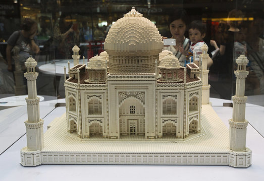 A woman takes pictures of a model of India's Taj Mahal, made from 8,000 pieces of Lego blocks, during the LEGO Piece of Peace-World Heritage Exhibition in Hong Kong