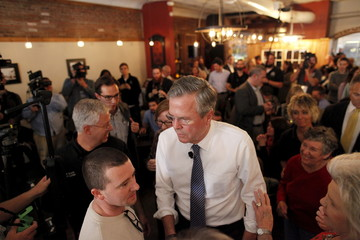 "U.S. Republican presidential candidate and former Florida Governor Jeb Bush works the crowd at a campaign ""meet and greet"" event at Wholly Smokin BBQ in Florence"