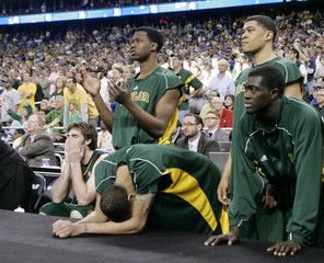 Baylor players react during final minutes of their loss to Duke at their NCAA basketball game in Houston
