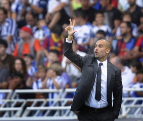 Barcelona coach Guardiola gives instructions during their Spanish first division soccer match against Real Sociedad in San Sebastian
