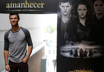 "U.S. actor Taylor Lautner poses for pictures during a photocall of the film ""A saga crepusculo: Amanhecer"" in Rio de Janeiro"