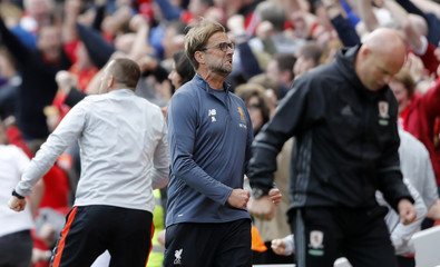 Liverpool manager Juergen Klopp celebrates after Liverpool's Georginio Wijnaldum scored their first goal as Middlesbrough caretaker manager Steve Agnew looks dejected