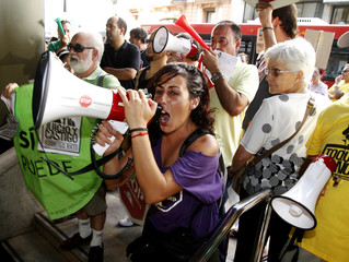 A member of the Mortgage Victims' Platform shouts as other activists occupy Bankia's central branch in Valencia