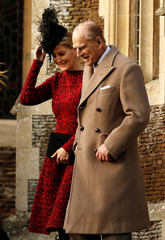 Britain's Prince Philip walks with Sophie Countess of Wessex as they leave the Christmas Day church service in Sandringham Britain.