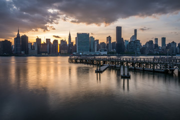 Manhattan skyline with Gantry Plaza State Park pier at sunset