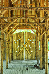 Old room with wooden pillars in the barn from the inside