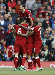 Liverpool's Philippe Coutinho celebrates scoring their second goal with team mates