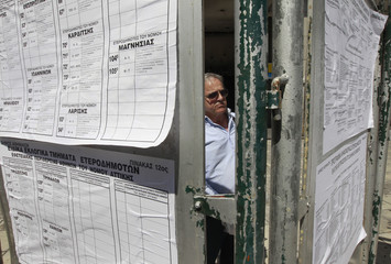 Man checks lists with polling stations one day before general elections in Athens