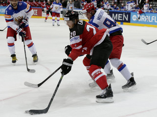 Russia's Mironov challenges Canada's Eakin during their Ice Hockey World Championship final game at the O2 arena in Prague
