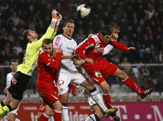 Admira's goalkeeper Tischler makes a save against Austria Wien's Margreitter during their Austrian league soccer match in Maria Enzersdorf