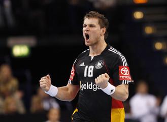 Germany's Michael Kraus celebrates after scoring against Sweden during their international friendly handball match in Hamburg