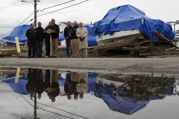 U.S. President Barack Obama talks to the media in a neighborhood after it was destroyed by Hurricane Sandy in New Jersey