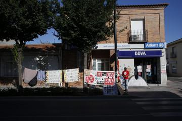 Rocio Cortes and her husband Sergio Moya camp outside a branch of Spain's second biggest bank BBVA in San Martin de la Vega