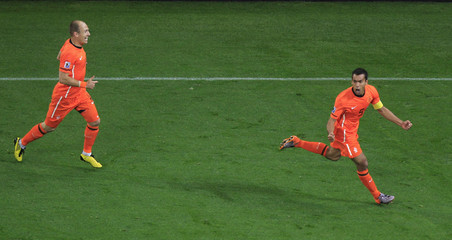 Netherlands' Giovanni van Bronckhorst celebrates his goal during the 2010 World Cup semi-final soccer match against Uruguay at Green Point stadium in Cape Town