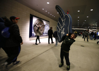Young fan carries a large foam hand before Game 1 of the MLB ALCS playoff baseball series between the Detroit Tigers and the New York Yankees in New York