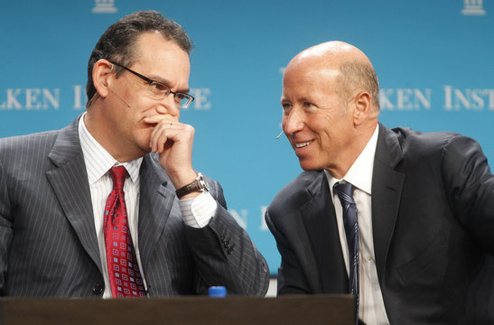 Simon, chairman and CEO of Simon Property Group Inc., talks to Sternlicht, chairman and CEO of the Starwood Capital Group, at the Milken Institute Global Conference in Beverly Hills