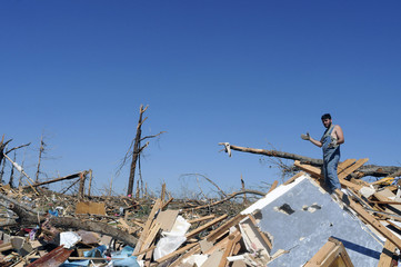 Tortorici stands atop rubble of the house he grew up in which was destroyed by a tornado in Pleasant Grove.